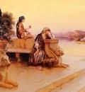 Rudolf Ernst Elegant Arab Ladies On A Terrace At Sunset