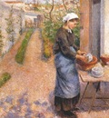 pissarro young woman washing dishes c1882