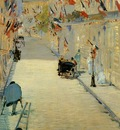 rue mosnier decorated with flags with a man on crutches