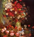 vase with poppies cornflowers peonies and chrysanthemums