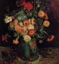 vase with zinnias and geraniums